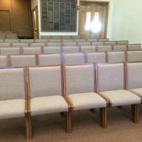 c 200 interlocking pew chairs, plus six with arms