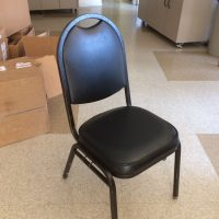 ~110 nice black interlocking stackable chairs suitable for banquet or pew arrangements